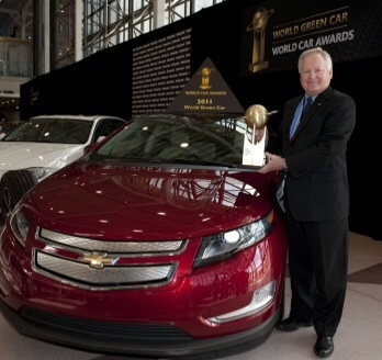 Chevrolet Vice President U.S. Marketing Rick Scheidt holds the 2011 World Green Car award for the Chevrolet Volt at the New York International Auto Show Thursday, April 21, 2011 in New York City. The Volt is an electric vehicle with extended range capabilities. Tailpipe emissions, fuel consumption, and use of a major advanced power plant technology (beyond engine componentry), aimed specifically at increasing the vehicle's environmental responsibility, are all taken into consideration by the judges for this award. (Photo by Steve Fecht for Chevrolet)