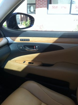 Lexus ES 300h interior is leather and wood lush. Yet fuel efficient.