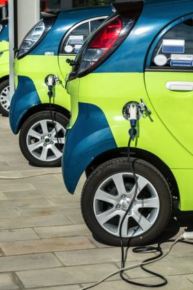 Top Image: Electric vehicle in car sharing station, Milan, Italy. Viappy / Shutterstock.com