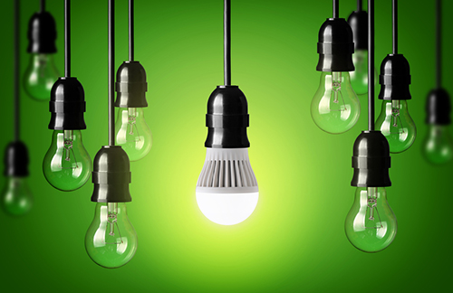 ACEEE discusses US states LED bulb and simple light bulbs.Green background