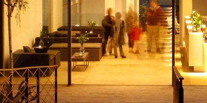 Hostal Spa Empuries people walking around the premises.