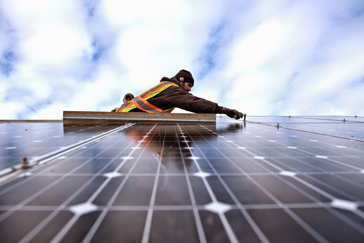 solar panels being installed for power