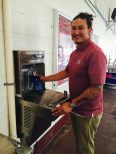 Refillable water bottle José Cerna NMSU closeup using reusable bottle at elkay water fountain. To go green in college