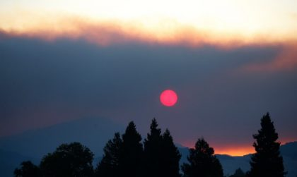 The rising sun pokes through smoke from the Nuns fire off Hwy 12 on Saturday, Oct. 14, 2017, in Santa Rosa, Calif. (Jim Gensheimer/Bay Area News Group)