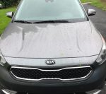 Front end grille Kia Niro Hybrid Electric Car. • Niro offers bold, crossover style and utility while providing exceptional fuel economy of up to 50 mpg combined1